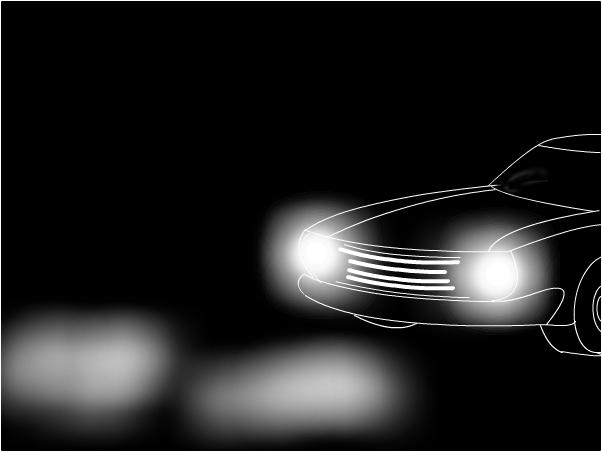 Headlights on dark road