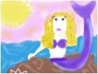 mermaid in the sun set